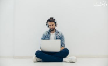 young man with laptop sitting on the floor 23 2147577277